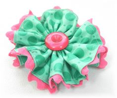 Ric Rac Trim Flower. Great way to use up scraps of fabric and trims! I think eyelet would look cute on the edge too.