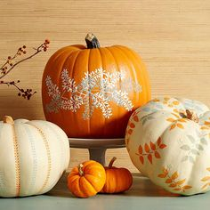 These simple, elegant pumpkins are extremely easy to make. Tape a stencil on a washed pumpkin, and gently paint the exposed area. Layer the stencil in different colors to get the looks shown here./