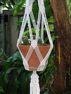 "The latest new design, White Macrame Plant Hanger Diamond in bright white bleached poly cotton twisted cord, perfect for 9"" (22 cm) diameter plant pot. Plant pot not included. Size: 44 ½"" (113 cm) ) overall length (top of the hanger to end of its tassel) Natural white (unbleached)"