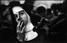 USA. NYC Harbour. July 1956. Nun waiting for survivors of SS Andrea Doria, an Italian ocean liner which collided with another ship near the coast of Nantucket. The survivors were brought to New York City.