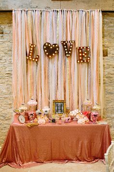 Sweet Table | Ribbon Backdrop | Sequin Tablecloth | Jenny Packham | Pink & Gold Colour Scheme | DIY Ribbon Backdrop | Oxlease Barn | Groom In Jeans | Hayley Savage Photography | http://www.rockmywedding.co.uk/claudia-matt/