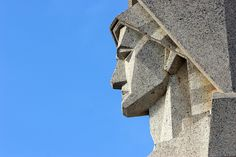 The image shows a detail of the ANgel, main feature of the ARt deco Facade of the cemetery of the City of Azul in Buenos Aires Province, Argentina. It was desoigned by the architect Francisco Salamone.