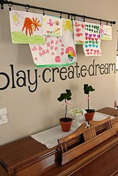 Cute way to display kids art work...This would be cute to hang in front of their bedroom windows (with solid color curtains as the backdrop).