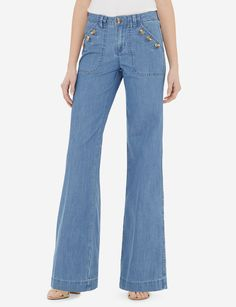 Everyday denim for the fashion focused woman! Our Denim Trousers have a mid-rise waist with flap front pockets and a flared leg.