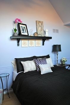 Possible idea for above bed- shelf with pics on it?