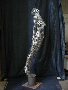 Stainless steel Nudes, Female sculpture by artist Rick Kirby titled: 'Soaring Figure (Stainless Steel Nude Woman sculpture)' £5835 #sculpture #art