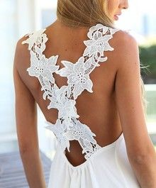 How gorgeous is the back of this dress? I love it!!! White Lace Criss Cross Back Mini Dress