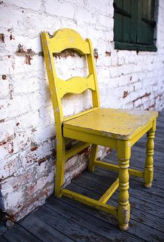 I think this chair has been sitting on its' New Orleans porch since the place was built in 1822.