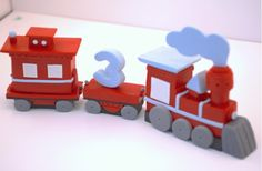Kadence's custom 3-D train cake topper made by Your Cupcake Story shop on Etsy