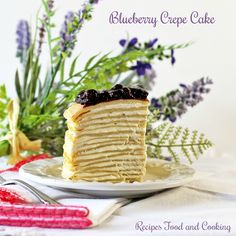 Blueberry Crepe Cake layers of crepes with a creamy cheesecake filling topped with blueberries.