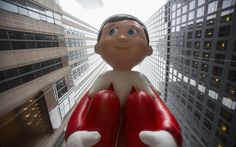 The Elf on the Shelf balloon floats down Sixth Avenue during the 88th Annual Macy's Thanksgiving Day Parade in New York  Picture: REUTERS/Andrew Kelly