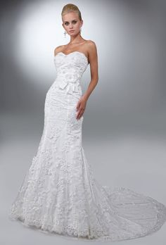 Brides: DaVinci. Lace and tulle mermaid gown with a sweetheart strapless neckline, and an attached trim at the waist that is accented with a bow. Low V zipper back.��See DaVinci Bridals on YouTube