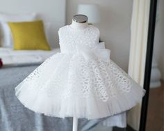 White Sleveless Knee Length Hollow Lace Flower Girl Dress One of Girly Favourites! This chic and elegant white flower girl dress is made perfectly! Perfect for Birthday, Wedding, Christening, Baptism, Communion, Summer Party Dress Or Baby Shower Gift. Available from 3 months until 12 years old  Color: White Material: Cotton, satin, soft polyester fiber, tulle mesh