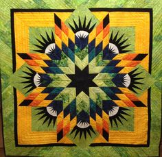 A WOW of a quilt. Read all about the collaboration between Jean and us.   Overthetopquilting.com
