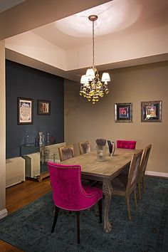 Color pop! Take soft dining room colors and add pizazz to the ends of a table with lively pink chairs.