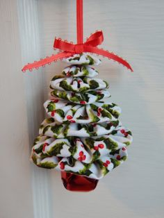 This is a lovely Christmas tree shaped ornament made from yo yos (fabric rounds) in a beautiful Christmas print of holly on a white background. Tree is