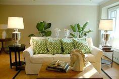 Those lamps! Those green trellis pillows!