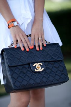 don't love the purse...however i do love the orange nails and watch and the white dress combo:) brilliantly fresh