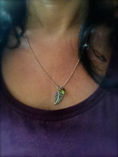 """Petite feuille"" (little leaf) pendant with a small green seed symbolising potential"