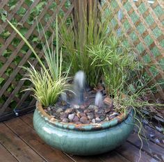 Small fountains in a small deck container provide whimsy and the melodic sound of water.