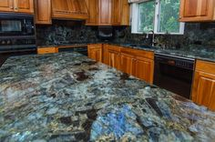 ...This is just too damn cool. As a geologist.....it's a must to have labradorite countertops!!!! Blue Granite Countertops, Granite Slab, Granite Kitchen, Kitchen Countertops, New Kitchen, Kitchen Ideas, Gemstone Countertops, Granite Colors, Granite Stone