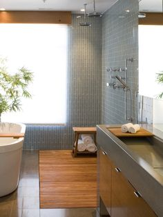 I love the colors and modern materials of the shower and bath. I'd choose a different sink option though.