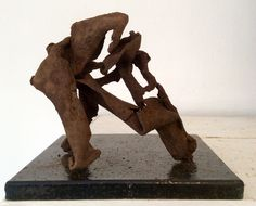 Four pieces of rusted scrap leaning against one another. Rick Farrell.