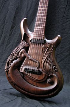 The sculpting in these custom guitars are too too sick!!!! Beautiful! I wish I knew how it sounded personally!
