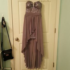 High-Low Dress great for Prom/Homecoming Events! ONLY WORN ONCE! Very cute, unique, clean, and metallic sequined dress. Lighly padded with a sweetheart neckline cut and a slit up the front to expose the connected skirt part of the dress. When I bought it at Dillard's, they said it was the last one! AS U WISH Dresses High Low