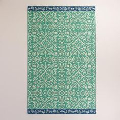 One of my favorite discoveries at WorldMarket.com: Blue Bordered Turquoise Tiles Indoor-Outdoor Rug