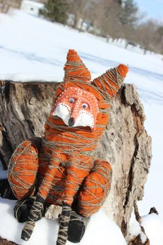 We made each part out of newspaper and masking tape. Then wrapped each piece in wool felt and then wrapped in wool string or yarn. I then hot glued for them all of the fox's body parts together. They sculpted the face out of sculpty and then painted it after I baked them. We were inspired not only by the video but also by Aboriginal art.