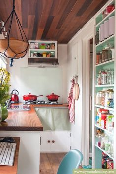 Fabulous kitchen - Young Family's DIY Tiny House on Wheels http://tinyhousetalk.com/young-familys-diy-tiny-house-wheels/?utm_content=buffer466fe&utm_medium=social&utm_source=pinterest.com&utm_campaign=buffer #TinyHouse #TinyHome #LiveSimple