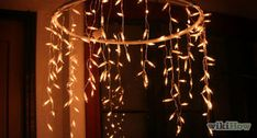 How to Make a Christmas Light Ball from Wire Hangers. Turn old wire hangers into a decorative lighted Christmas ball. It's a simple makeover which looks very effective when the lights are switched on and the ball is strategically placed. Hula Hoop Chandelier, How To Make A Chandelier, Wheel Chandelier, Mason Jar Chandelier, Flower Chandelier, Diwali Decorations, Handmade Decorations, Christmas Decorations, Best Christmas Lights