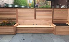 Built-in cedar storage bench and planters for small backyard space. Horizontal cedar fencing and bluestone patio. Garden Storage Bench, Bench With Storage, Built In Storage, Planter Bench, Planters, Outdoor Spaces, Outdoor Living, Cedar Bench, Small Patio Design