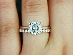 Rose gold band with a diamond and different wedding band. Still kind of want a halo around diamond tho! Engagement Ring Photos, Wedding Engagement, Round Solitaire Engagement Ring, Wedding Band Engagement Ring, Engagement Rings Gold Yellow, Wedding Ring Set, Platinum Engagement Rings, Antique Engagement Rings, Different Engagement Rings