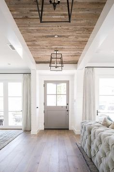 Modern Farmhouse Gray Glass Panel Door with Iron Lanterns Hanging from a Plank Ceiling Over a Gorgeous Wood Floor. Modern Farmhouse Gray Glass Panel Door with Iron Lanterns Hanging from a Plank Ceiling Over a Gorgeous Wood Floor. Flur Design, Home Design, Design Ideas, Design Inspiration, Quinta Interior, Interior Modern, Interior Design, Modern Decor, Modern Entry