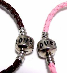 """Pink & Brown 8"""" Inch Pandora & Chamilia Compatible 'Love' Charm Starter Bracelet, Braided Woven Leather, Tarnish-Resistant Silver Plated Snap Box Barrel Clasp, 2-Pack Bracelet Set Ziva, LLC. $17.99. Product photos are of the actual piece you will receive-no CGI. Get 15% off your order when you order 2 or more items sold by Ziva, LLC (20% for 4 or more)-use claim code SHOPZIVA at checkout. Genuine leather. Fits beads with 3mm core. Save 61%!"""
