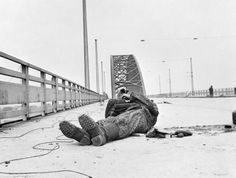 Nijmegen and Grave 17 - 20 September 1944: The bridge at Nijmegen after it had been captured by the 82nd (US) Airborne Division. A dead German SS officer lies where he fell during the attack.