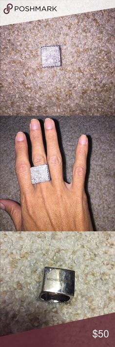 Michael kors ring Gorgeous ring! I'm good condition , a stone missing but hard to tell. Minor scratches / wear. Posted pics, happy to post more if needed Michael Kors Jewelry Rings