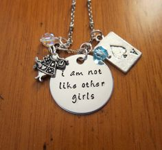 Alice in Wonderland Inspired Necklace. I am not like other girls. Silver colored. Swarovski crystals.