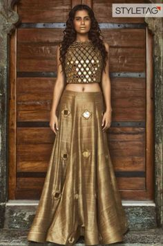 lehenga blouse design in golden color and mirror work