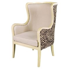 Carmella Arm Chair - Hollywood Regency meets safari style in this chic wingback chair, highlighted by nailhead trim and zebra-print upholstery. (=)