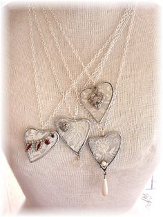 for Amy….Soldered glass hearts with vintage lace sandwiched in between the glass.   Up cycled jewelry pieces added so each one is very unique. OOAK. from Trash to Treasure Art - #upcycle #jewelry #crafts #soldered #glass #hearts #vintage #lace #Valentines #Day #handmade #gifts tå√