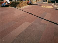 Granite: Eco Outdoor Tawny granite paving in commercial application