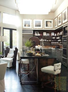 The kitchen exhibits subtle hints of Belgian breeding in the way iron and wood co-exist. The cowhide covered barstools is the ultimate in old world comfort. By Bobby McAlpine