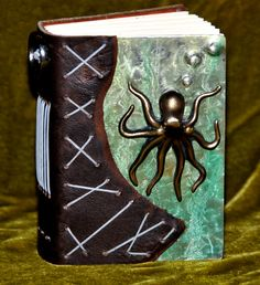 A small Metal Octopus Journal | Sustained Confusion-Tracy Moore. I wish I had bought this at artfest.