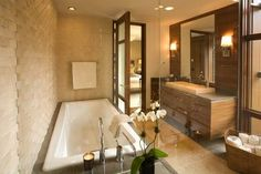 contemporary bathroom by jamesthomas, LLC bathtub clad with same marble as counter top