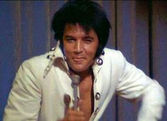 "Elvis - love that smile, the sexy up to ""no good"" good kinda smile that makes your toes curls. Lol."