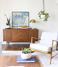 The new kind of minimalism is warm and welcoming with the addition of wood tones and a bunch of fresh green plants.