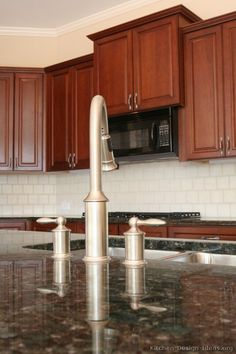 #Kitchen Idea of the Day: Cherry-Colored Cabinets. Main faucet in the island.